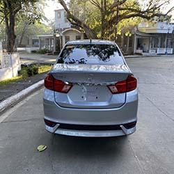 2020 silver honda city car for hire rear view
