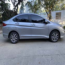 2020 silver honda city car for hire right view