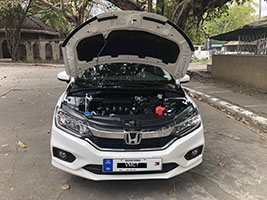 honda city car for rent in manila front view hood open
