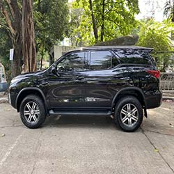 left view black fortuner suv for hire